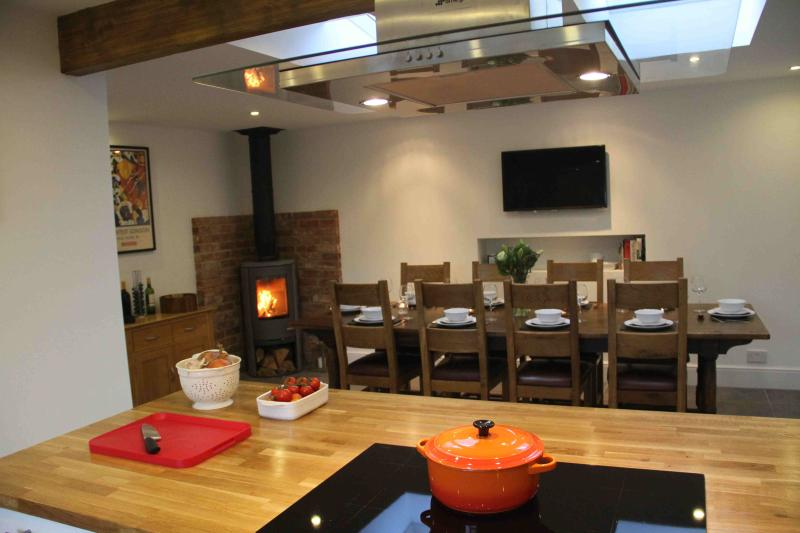 Ten guests can happily sit down for dinner together, in the social kitchen/dining area.