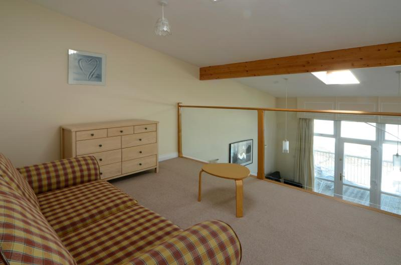 Waterfront luxury accommodation - mezzanine level which can be a third bedroom or a second lounge