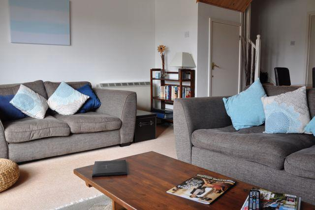 Contemporary open plan living area to relax and unwind after a day of activity at Fountain View