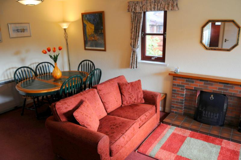Well laid out lounge / dining room with TV and DVD at Coire Cas