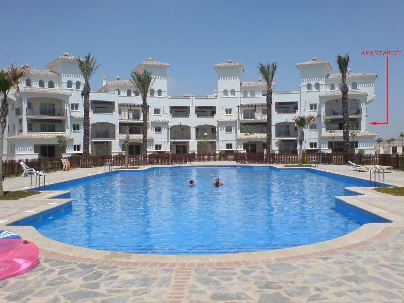 Photo of Apartment from pool, taken on a hot July