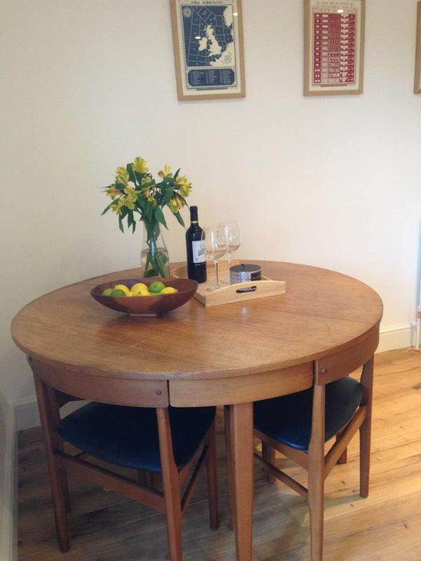 Second dining table in the living room.