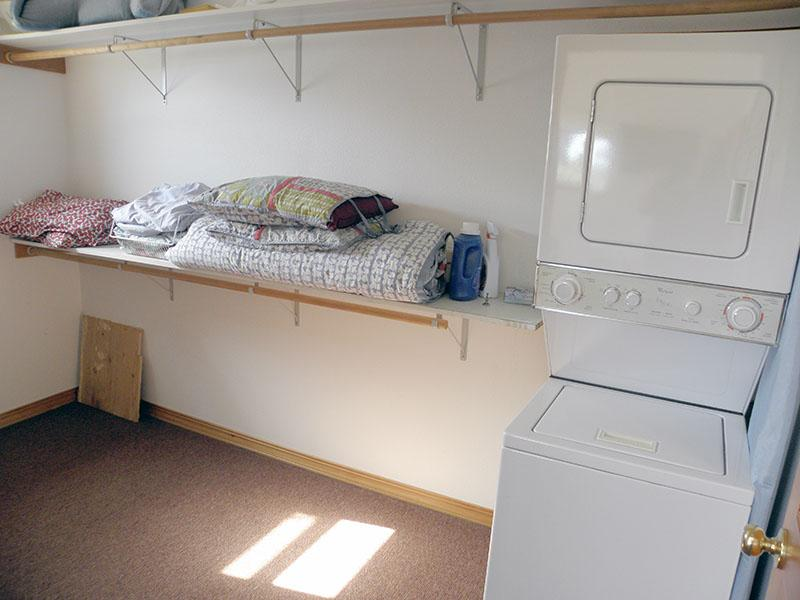 The second floor has its own laundry room.