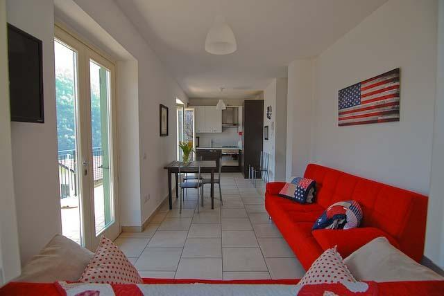open plan living area with double patio doors