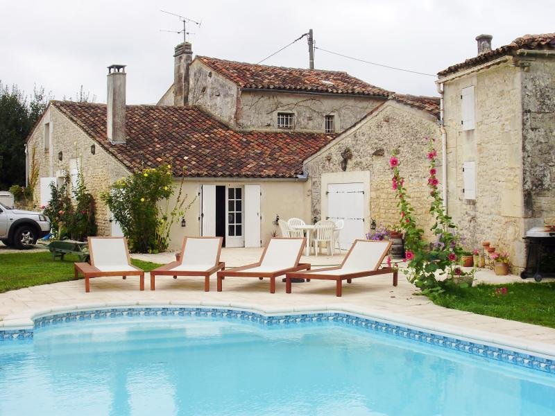 The property and terrace from the pool