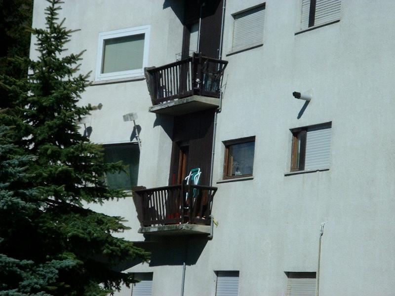 balcony with deckchairs