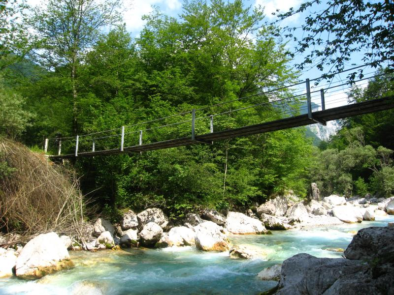Hiking across number of footbridges across So?a, Tolminka, Nadiža, Koritnica and many others