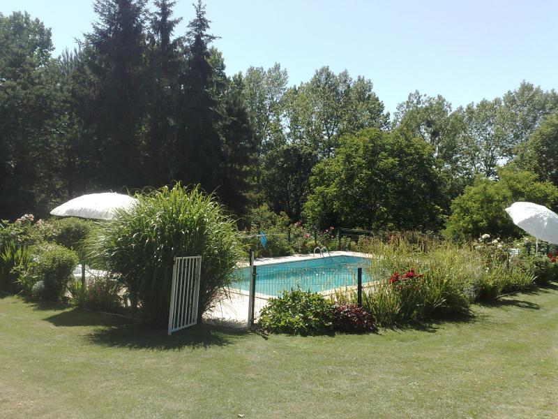 Large gardens around pool area