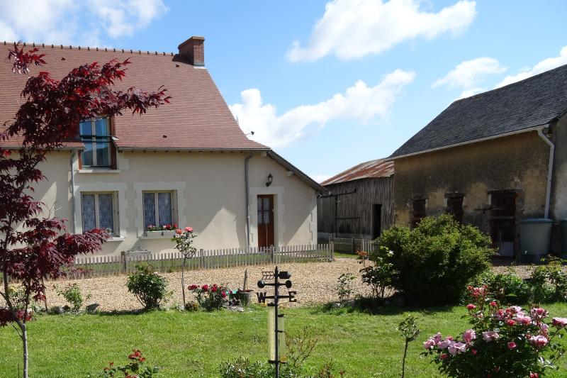 Le Petit Bosquet, one end of a Longere Farmhouse, with Rose garden courtyard to the front.