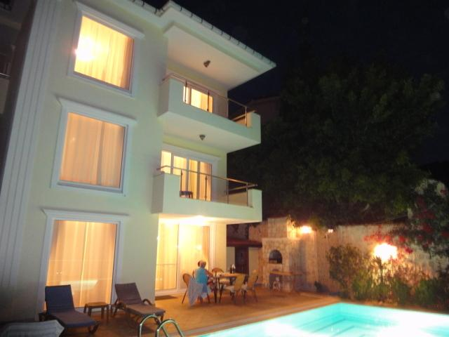 Villa at evening time. Have a relaxing Bar-b-q beside the pool with just the odd glass of wine.
