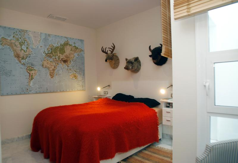 large and comfortable master bedroom (the 'trophies' are plush toys)