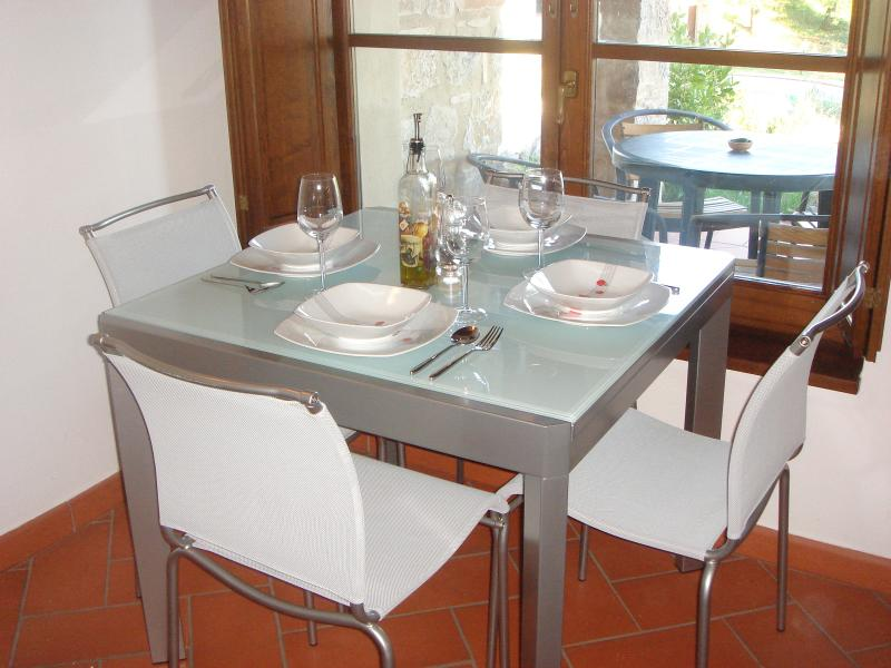 Dining area with table and chairs for four people