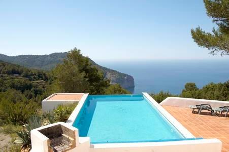 Infinity-edge pool and sun terrace with spectacular sea view