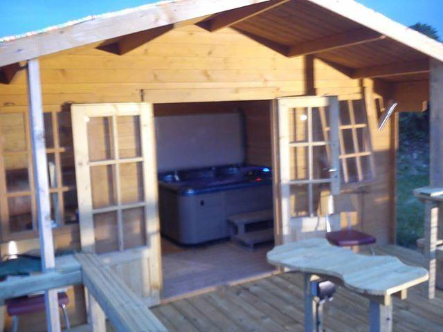 Log cabin with hot tub