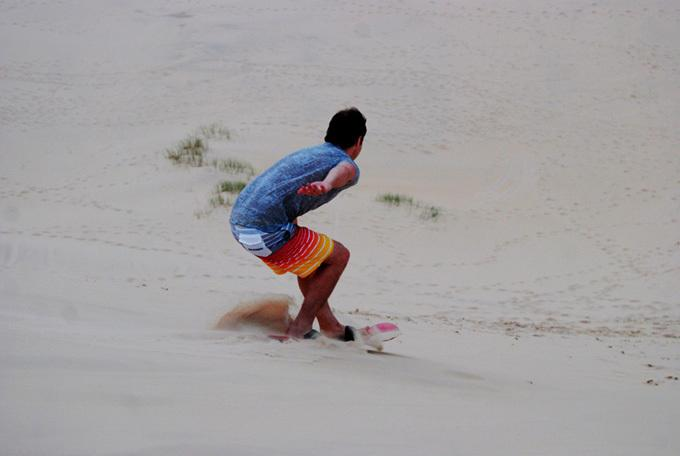 sand board on Joaquina's dunes