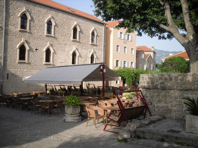 Take an evening stroll in Budva. Enjoy a meal or a drink in one of its many squares.