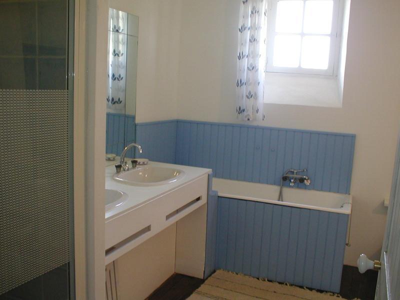 family bathroom with twin washbasins, bath, shower, bidet and wc