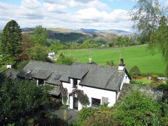 Detached cottage with car port. View from the top patio across the rooftop to Langdales