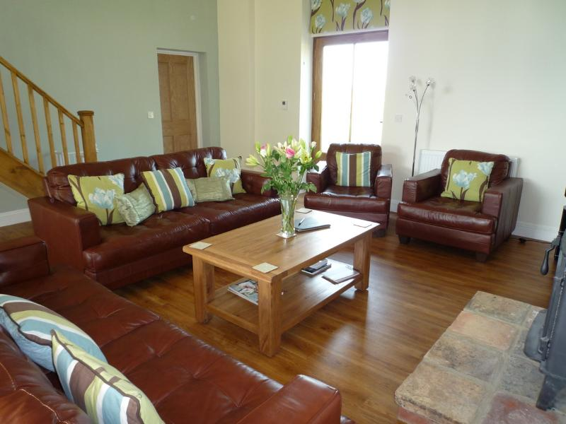 The main sitting room with vaulted ceiling & wood burner