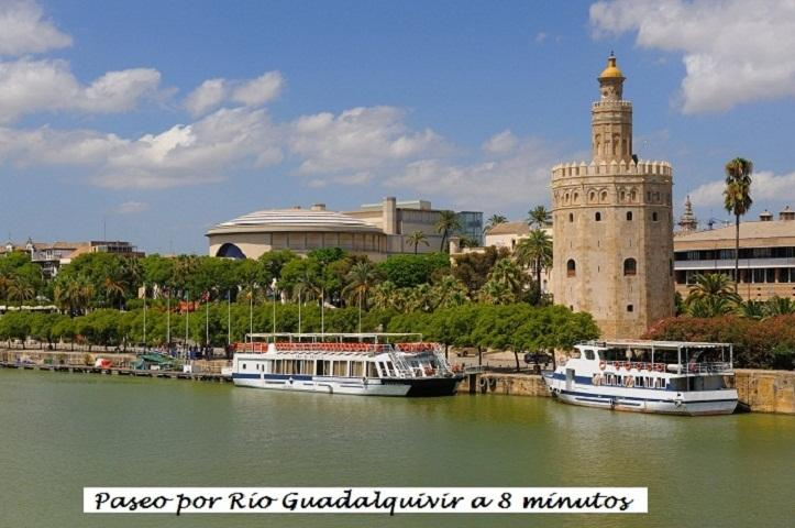 Walk along the Guadalquivir River just minutes