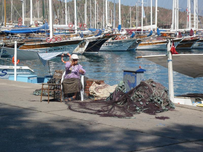 Fethiye, mending the fishing nets at the harbour