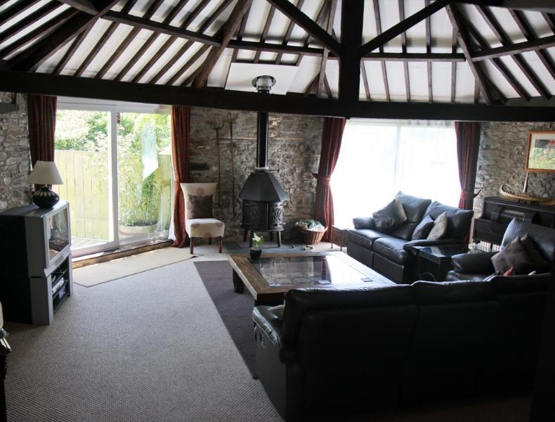 Lounge now with very large flat screen TV. Wood burning stove plus C/heating
