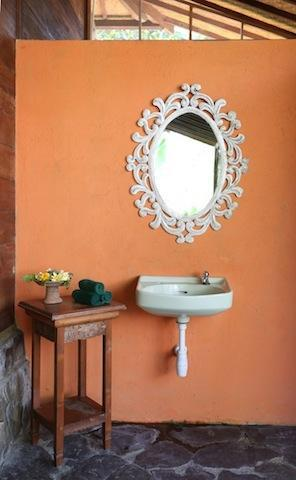 Orange walls with carved wood mirror
