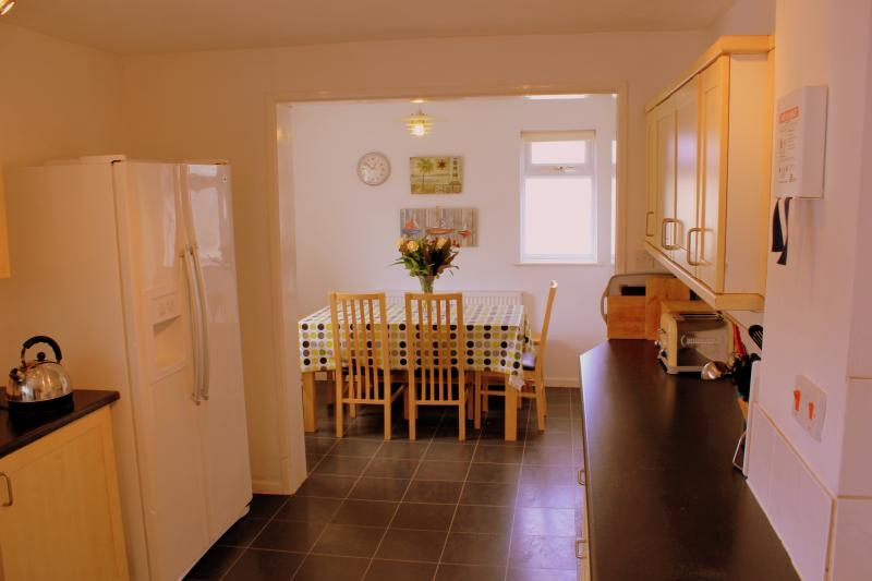 Spacious kitchen/dining area with American style fridge freezer and breakfast bar
