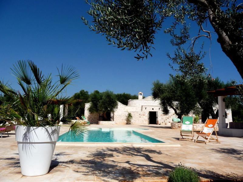 Trullo Fico and its private pool and patio lined with ancient olive trees