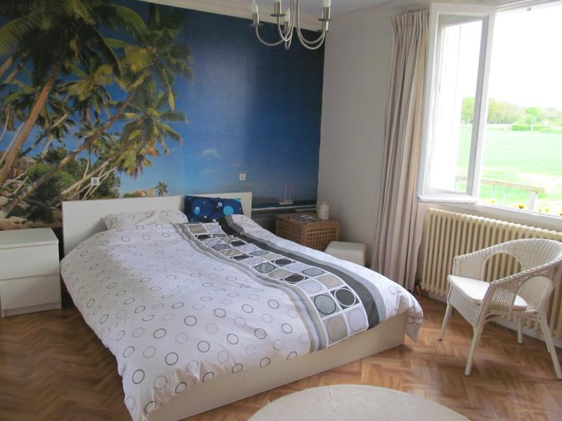 Master bedroom with views on fields