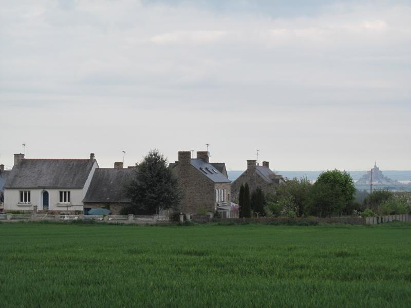 House on left with view of Le Mont St. Michel in the background