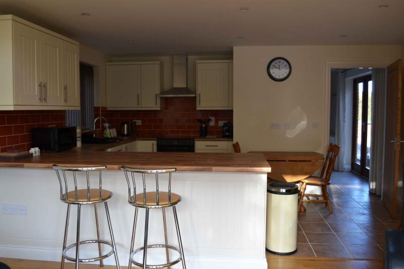 Open plan kitchen with breakfast bar