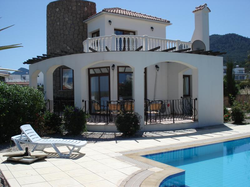 villa , sea front location, with mountain views, Dine on the safe secure terrace.
