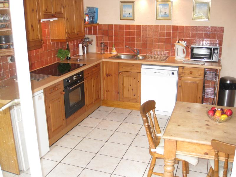 Kitchen from Garden (adjacent area with large storage cupboard and 6ft fridge/freezer)