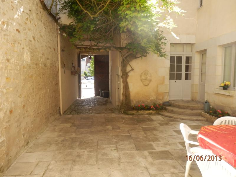 View of central courtyard, opening onto Place du Marche, from Garden House entrance.