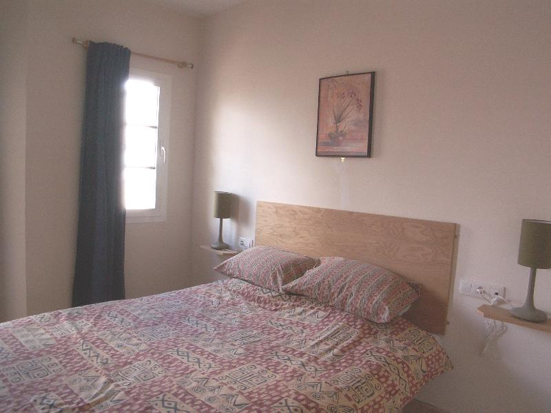 Double bedroom with safe and air conditioning on first floor.  Has own balcony with lockable door