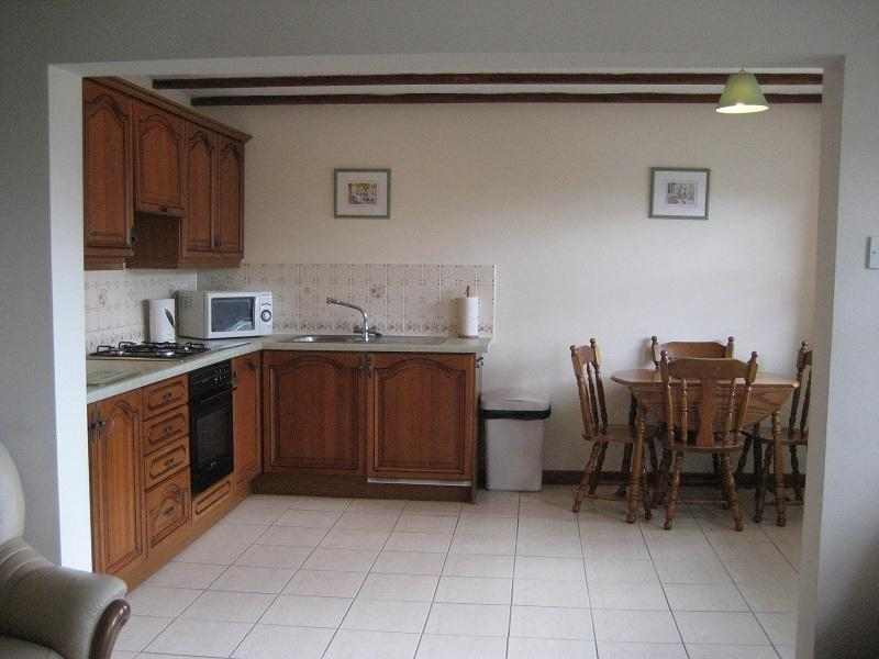 Forge Cottage kitchen and dining area with full size cooker, microwave, fridge etc.