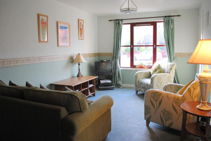 Bright, spacious lounge/dining room with TV, DVD and double bed settee