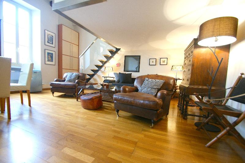 Large spacious sitting room with two long double glazed windows & quality furnishings
