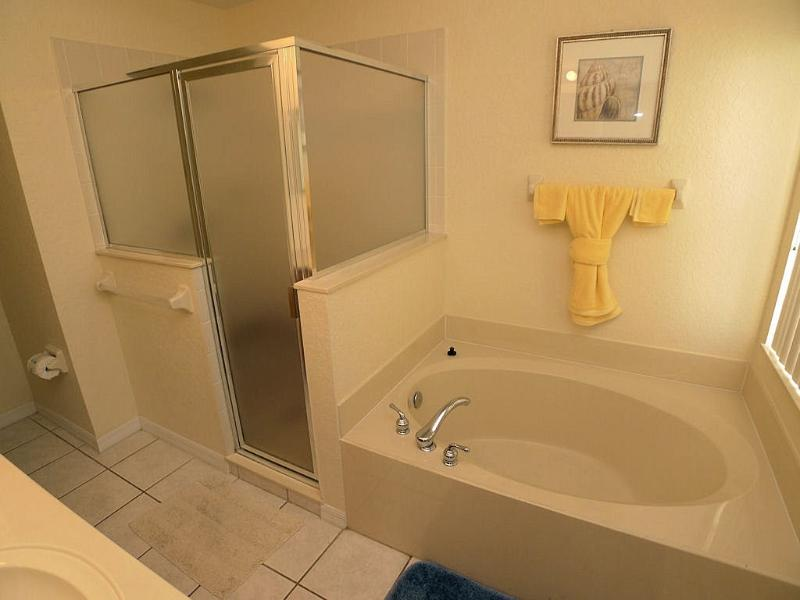 Master en suite with separate shower and large garden bath