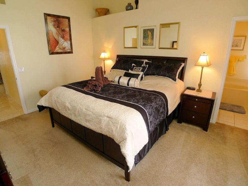 Master bedroom with king size bed and walk in wardrobe