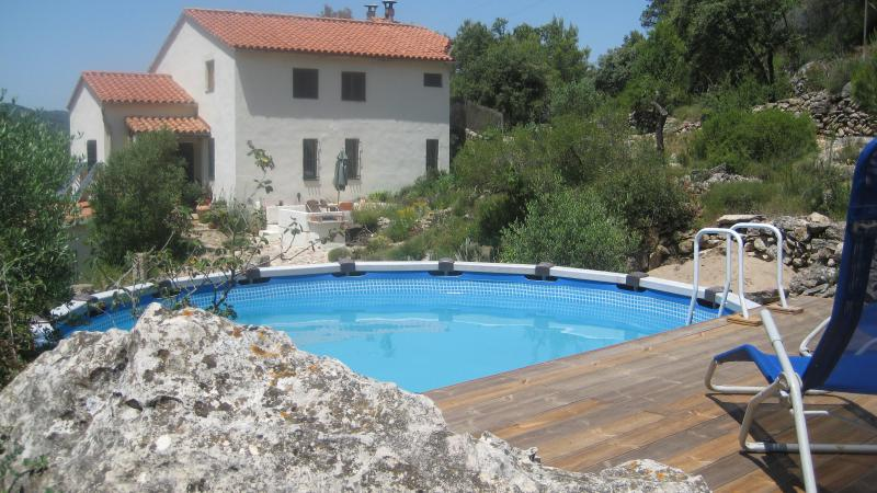 swimming pool with deck near the house