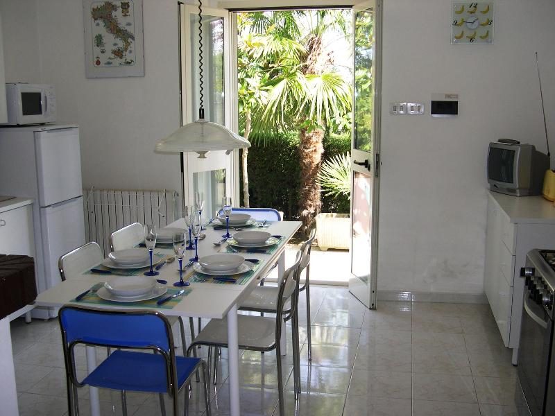 Well-equipped kitchen, with patio doors