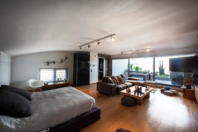 Bedroom with living room , TV ,terrace
