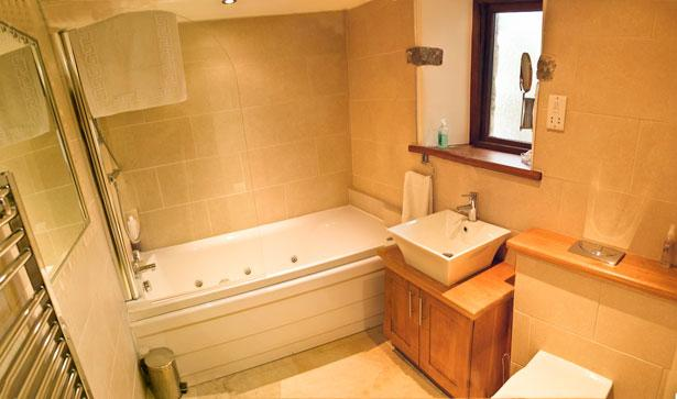Ground floor family bathroom with whirlpool bath. Listen to your i pod while you are in the bath!