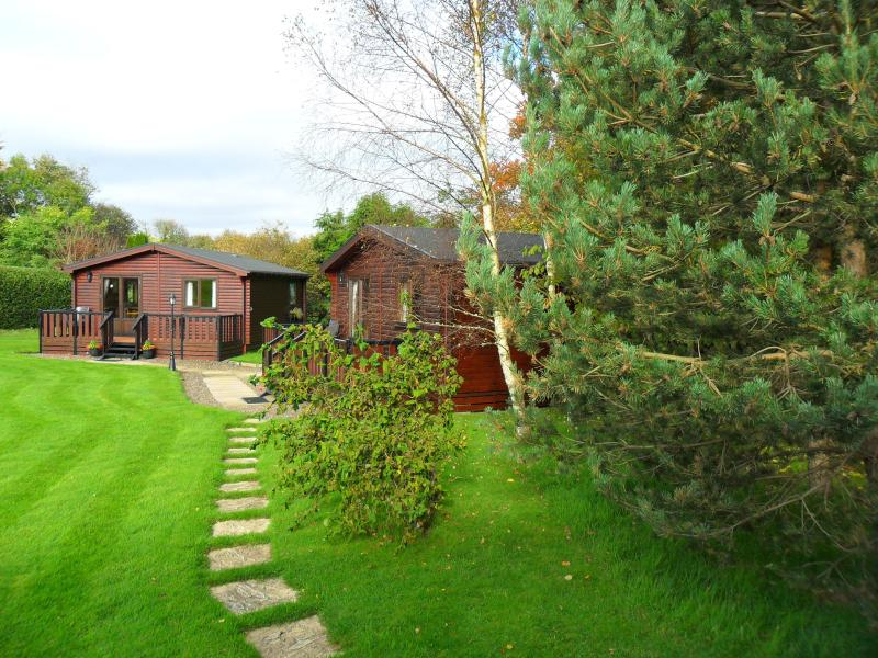 lodges situated within open lawns each with decking / furniture for a relaxing break, easy access