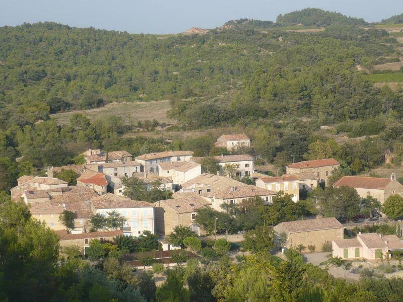 The hamlet, set in the vineyards and rolling wooded hills of the Minervois