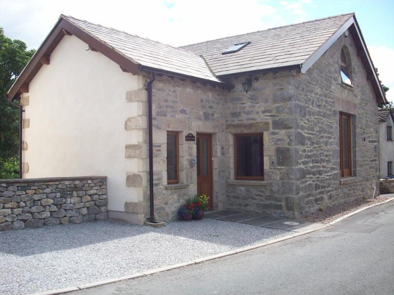 Detached stone built conversion on very quiet back lane of Ingleton. Private parking  front & back.