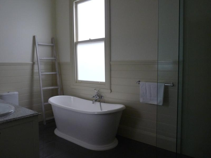 Gorgeous double vanity bathroom with toilet,walkin shower and french soaker bath. 2 toilets.