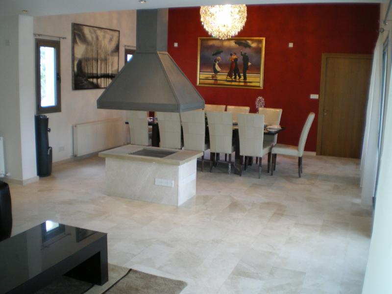 Large open plan living area from lounge to formal dining room, all overlooking swimming pool & p